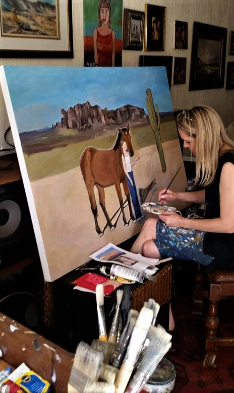 Busy with a commissioned painting of a horse and a girl.
