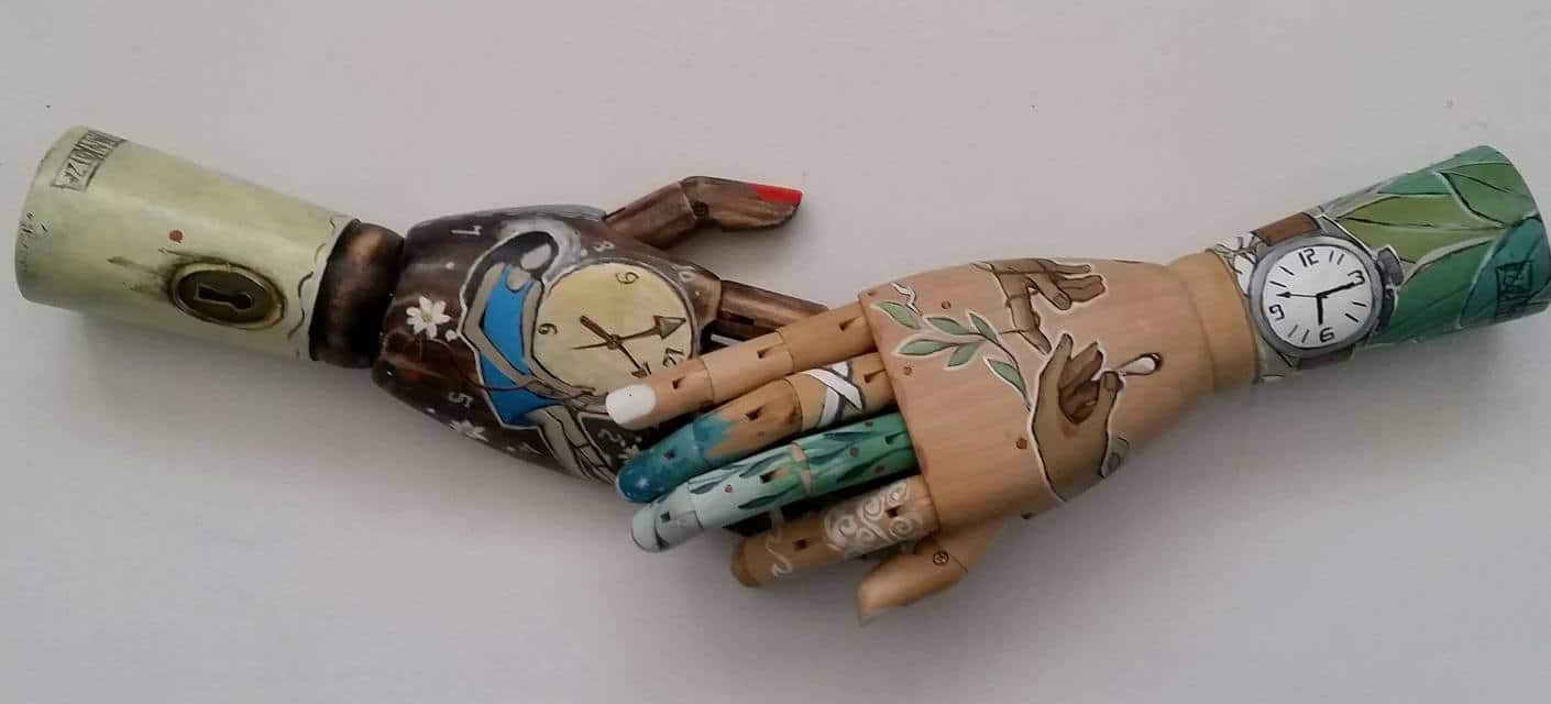 Painted wooden hands - these two hands were commissioned by clients.