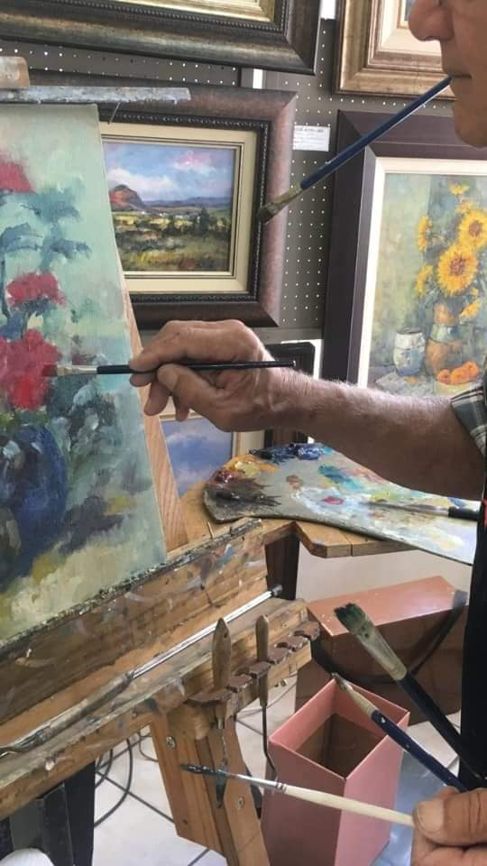 Kobus working on a floral painting